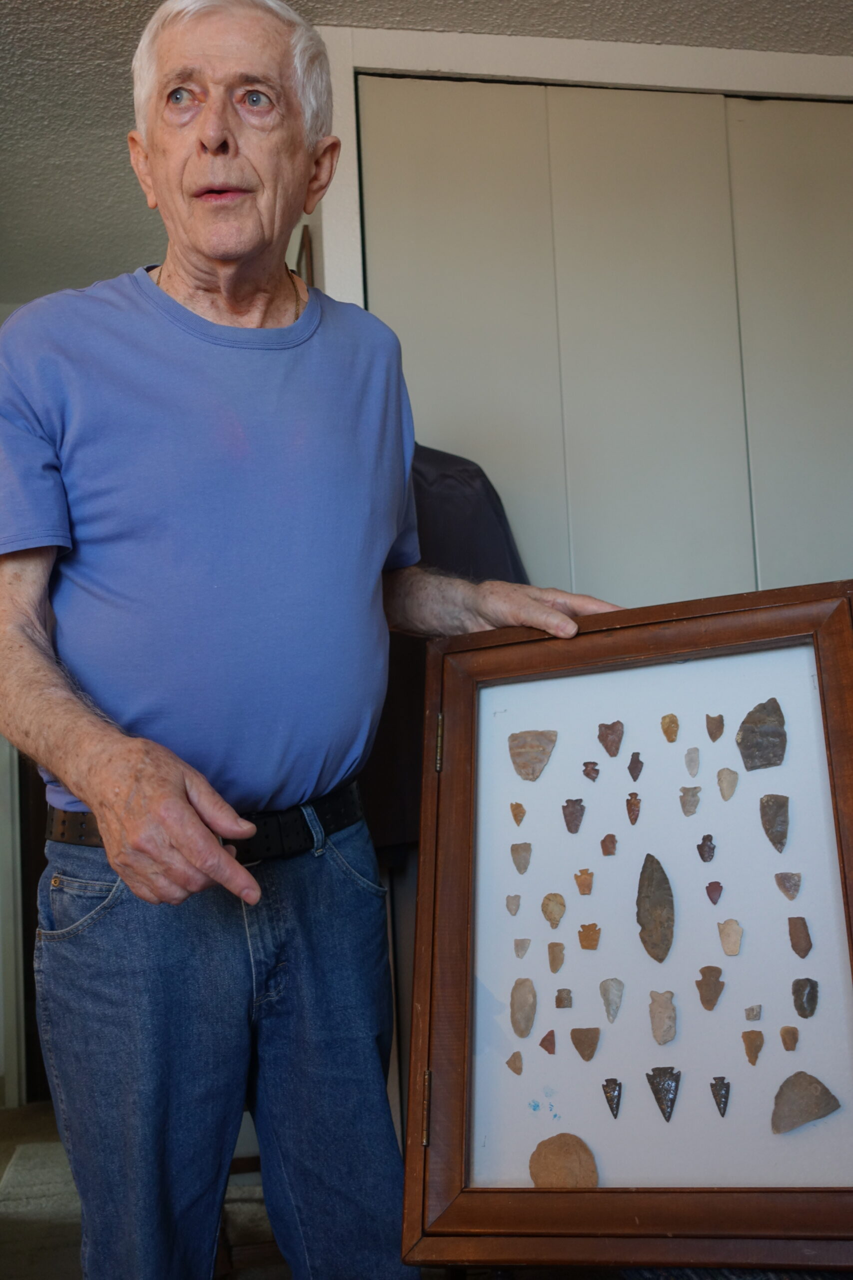 resident showing his arrowhead collection