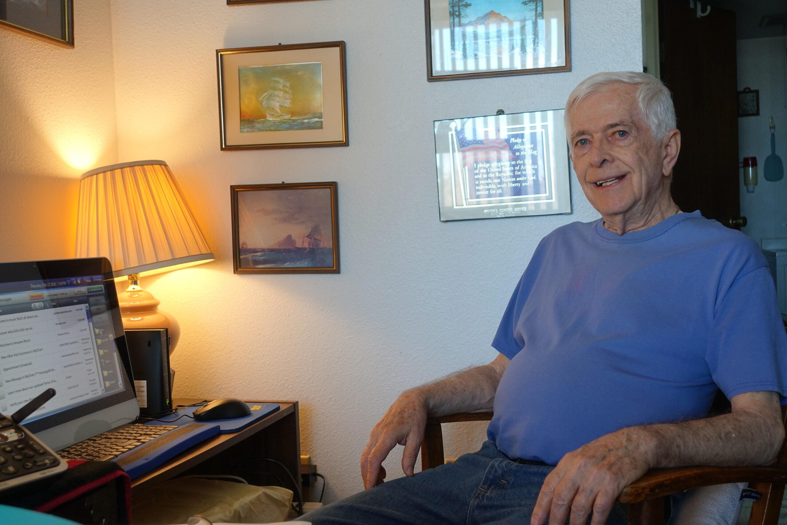 senior resident Gary sitting in living room