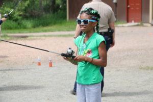 happy kid fishing with sunglasses