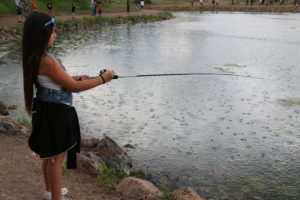 kid fishing in light rain