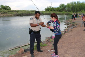 Colorado Parks and Wildlife staff helping kids learn to fish