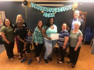 winning student with family and Mercy Housing Lakefront staff