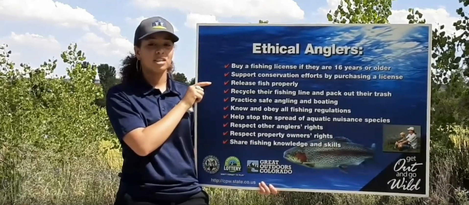 instructor teaching fishing class at a forested area