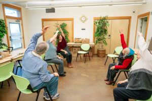 Senor residents participating in chair yoga