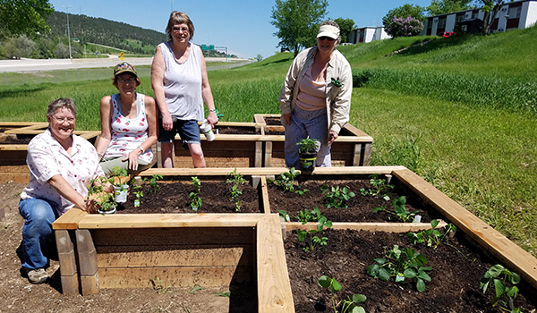 Mercy Housing residents in South Dakota participate in the preparation, planting, and maintenance of their community garden, named Shire Garden.