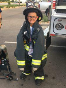 kid in firefighter uniform