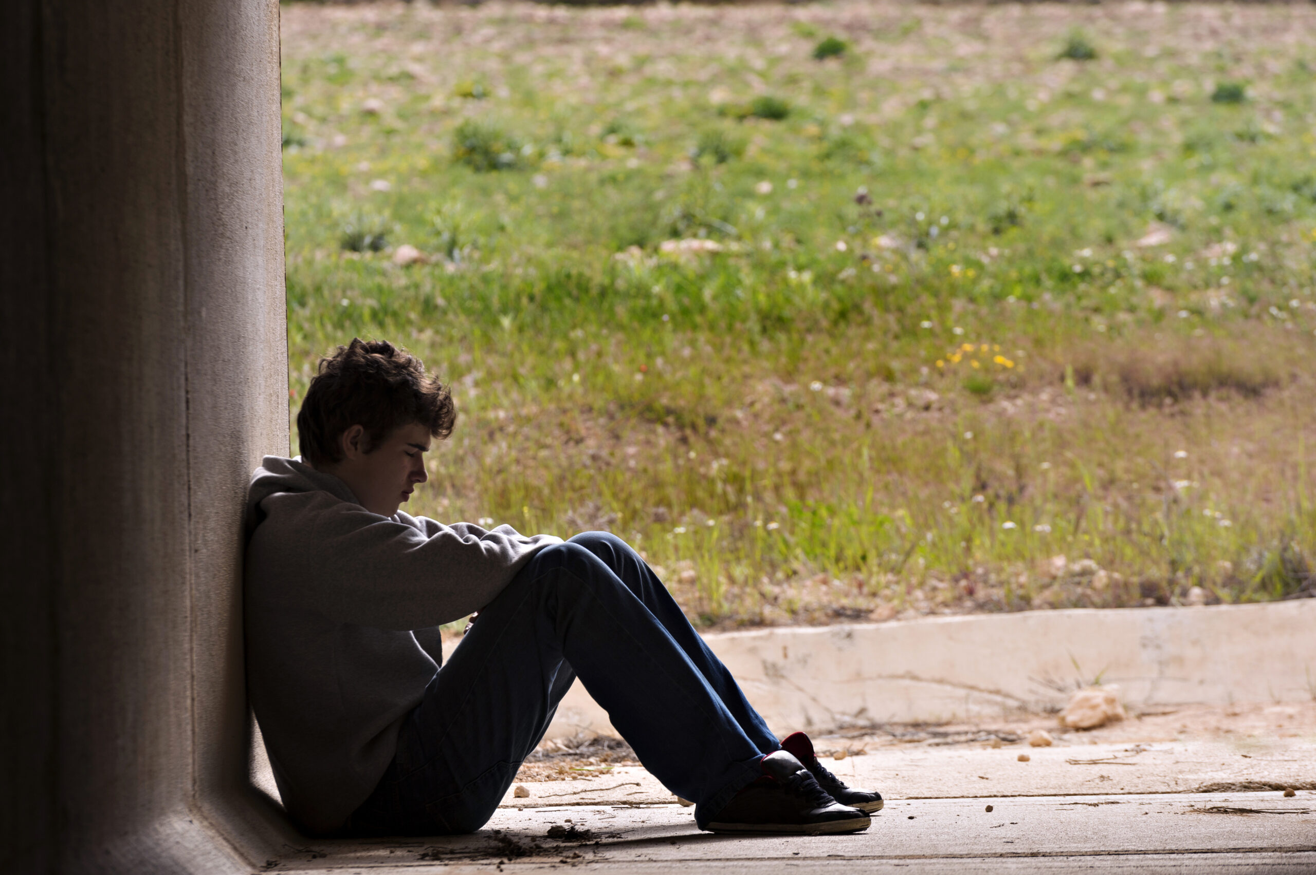 teenage boy looking sad, housing, unemployment, supply of housing
