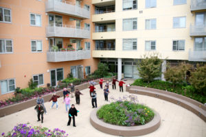 seniors doing tai chi at a Mercy Housing property in California