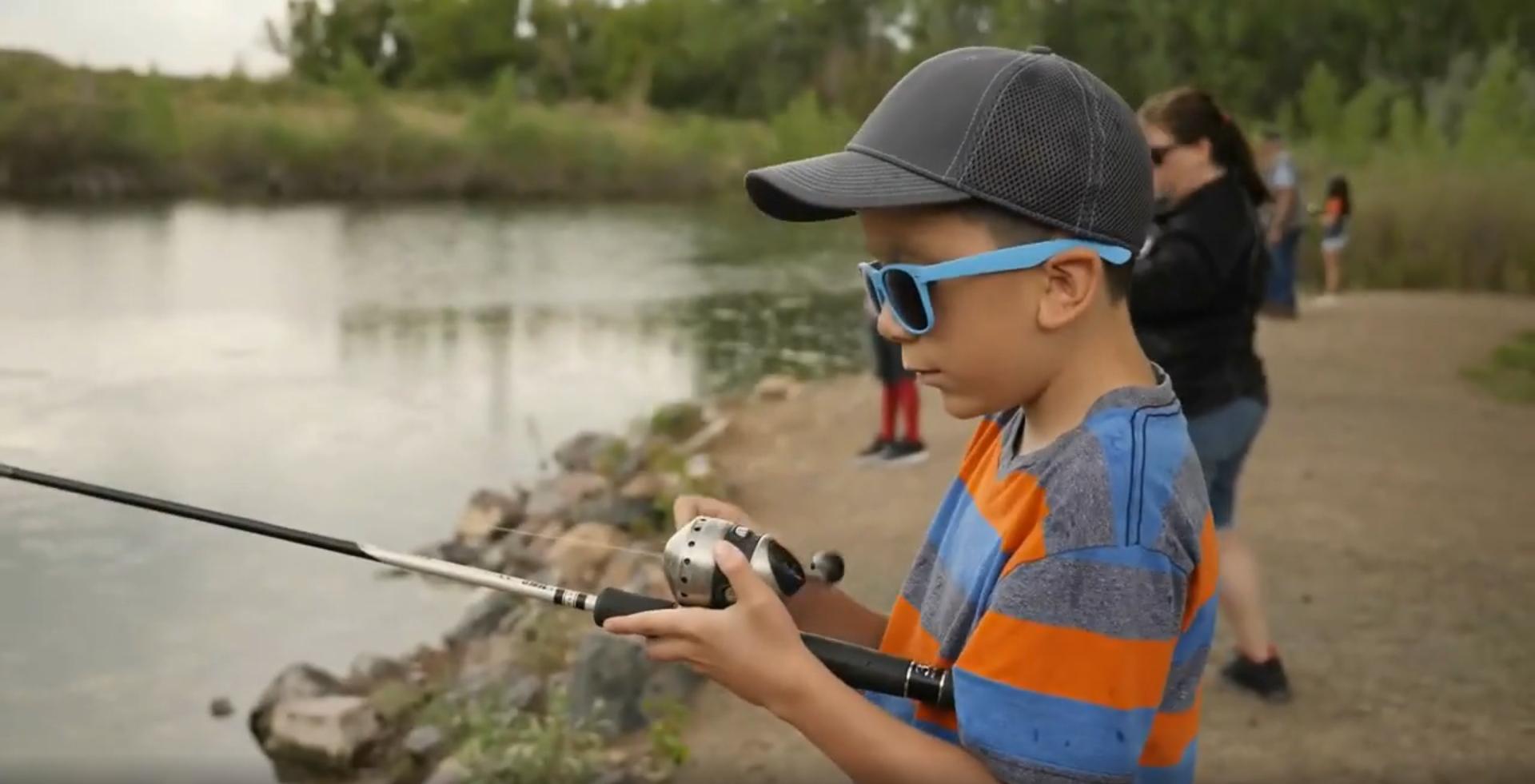 kid fishing at lake