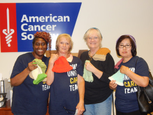 The knitting team: Terrie, Terry, Nanci, and Jung