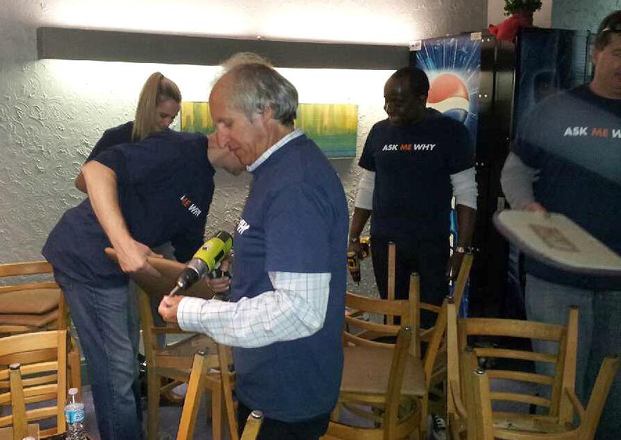 PrivateBank volunteers reupholstering chairs