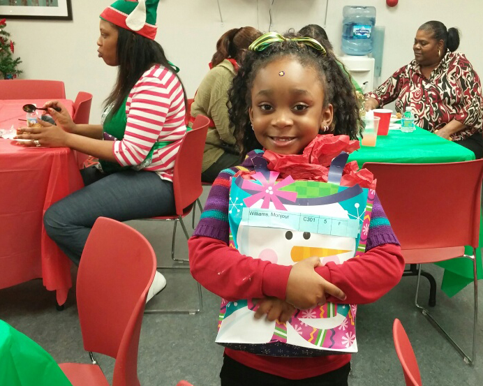 Children receiving holiday gifts at Pullman Wheelworks