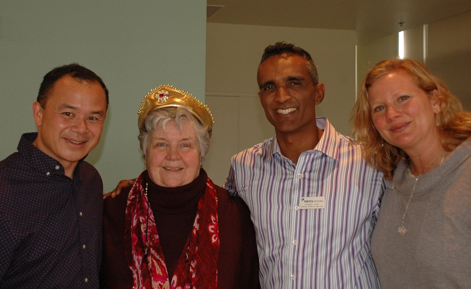 Sister Patsy with her team, celebrating 25 years at Mercy Housing