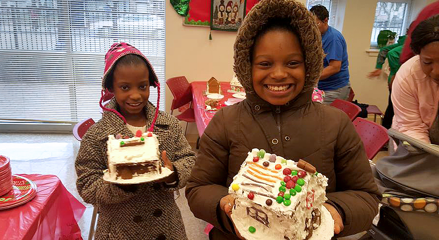 Helping children make gingerbread houses at Wentworth Commons