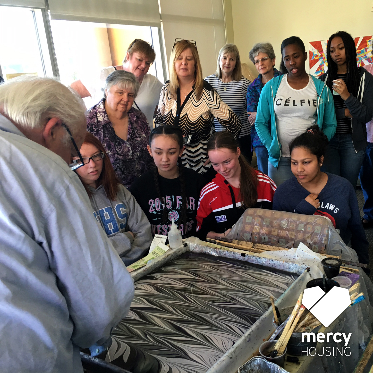 Mercy Housing resident, David, sharing his artwork with visitors