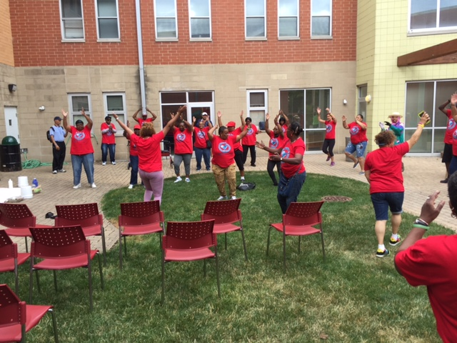 Residents and staff exercising together