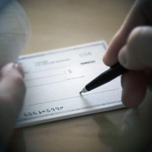 A renter writing a rent check