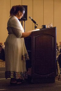 Tenaye smiles while delivering her remarks at MHNW's Power of Home breakfast at the Seattle Sheraton.