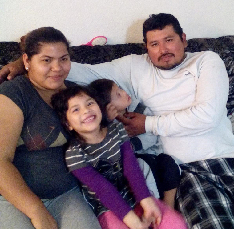 Maria and her family relaxing at home