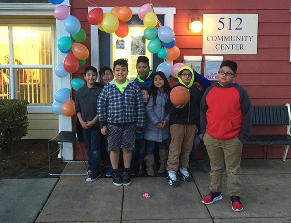 1385_Kids outside of community center w balloons