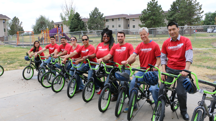 Janus Henderson Investors employees, lined up on the bikes they built