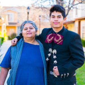 Roberta and her son Roberto stand outside Villa Madera