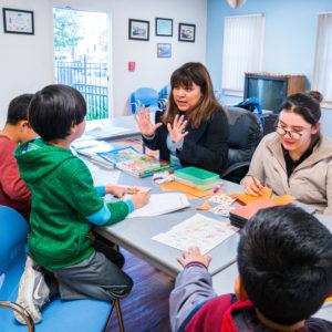Yajaira teaching after-school at Casa San Juan