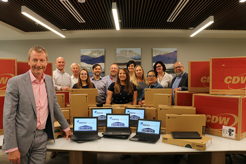 EPIC office team with Chromebooks