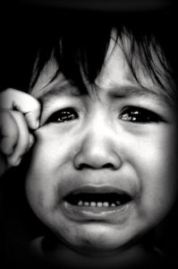 A child crying, with photo credit to Fairuz Othman