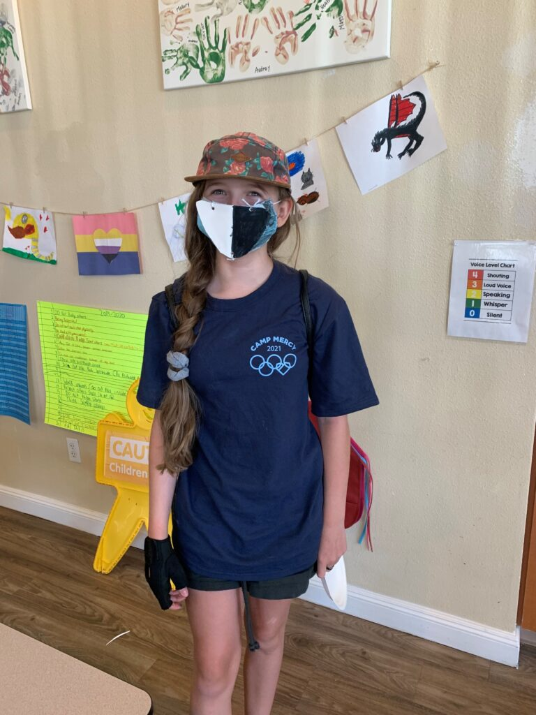 Youth Wearing Mask and T-Shirt at White Rock Village
